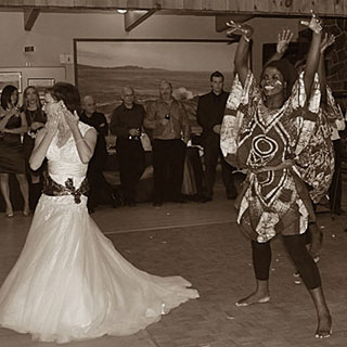 Multi-ethnic wedding during which a Québec woman participates in an African dance to celebrate her husband culture.