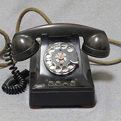 Bakelite telephone made of metal and plastic, circa 1935. It is a 3-line phone.