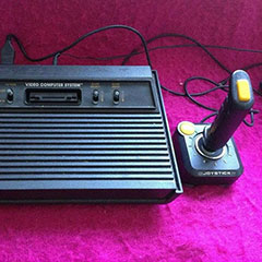 Atari game console with its controller.