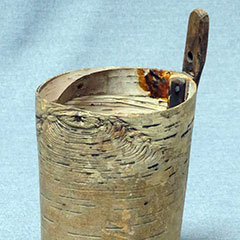 Maple sap bucket made in the 19th century from birch bark.