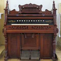 Harmonium made of mahogany, ivory, metal and resin and built by Thomas Organ & Piano Co.