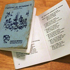 Two small collections of songs for Scouts. The cover of one of the books can be seen, while the other book lays open.