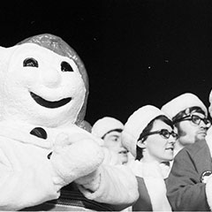 Bonhomme Carnaval applauds alongside members of the Canadian delegation during the Saskatoon Winter Games.