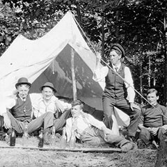 A group of six men are camping at Lake Muskoka in Ontario.