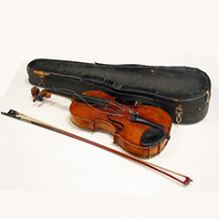 Violin and its bow next to their case.