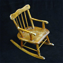 Rocking chair, or rocker, made of wood.