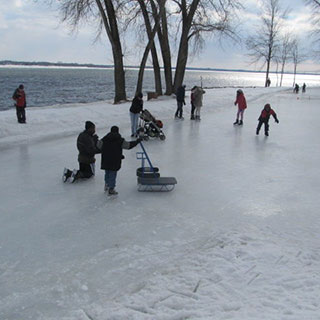 People skate on a frozen trail near the Saint Lawrence River.