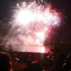 A crowd observes the fireworks of the Trois-Rivières Grand Prix from the port park of the city in August, 2014.